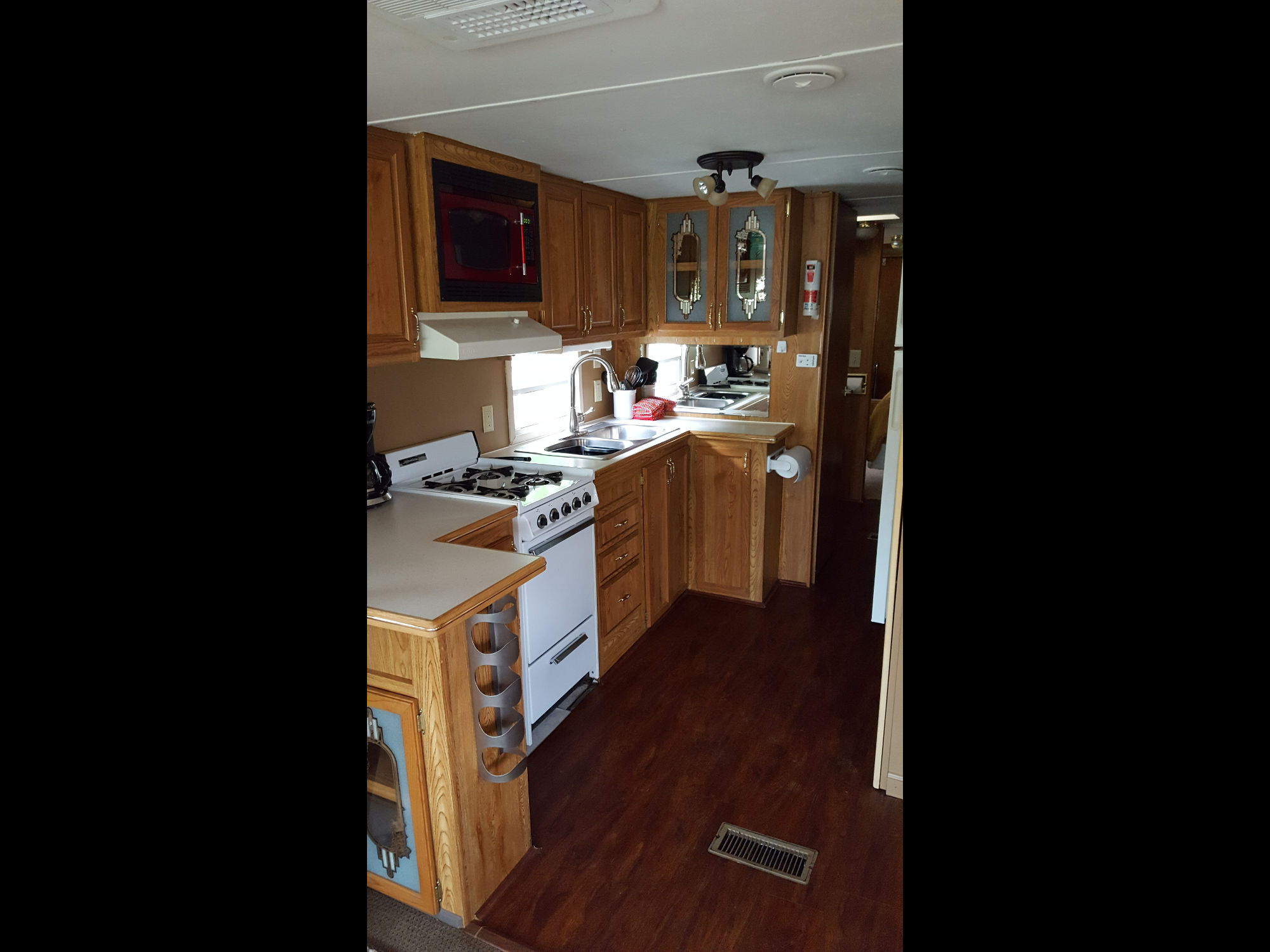 Deluxe trailer interior view of kitchen